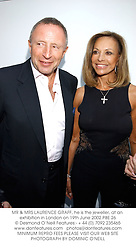 MR & MRS LAURENCE GRAFF, he is the jeweller, at an exhibition in London on 19th June 2002.PBE 26