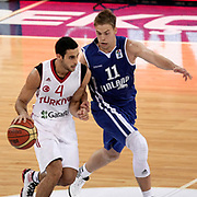 Turkey's Dogus Balbay (L) and Finland's Petteri Koponen during their Adidas Istanbul Cup 2012 Final basketball match Turkey between Finland at the Abdi I˙pekci Arena in Istanbul Turkey on Thursday 02 August 2012. Photo by TURKPIX