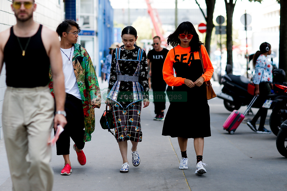 Street style, Sherry Shen and Yoyo Lu arriving at Acne Spring-Summer 2019 menswear show held at Bercy Popb, in Paris, France, on June 20th, 2018. Photo by Marie-Paola Bertrand-Hillion/ABACAPRESS.COM