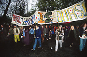 The Land is Ours is a British land rights campaign advocating access to the land, its resources, and the planning processes. The group was set up in 1995 by George Monbiot and others. Their first campaign was the occupation of the disused Wisley Airfield in Surrey by 400 people in 1995 from which there was a live broadcast on the BBC's Newsnight programme. Nearby St. George's Hill is symbolically significant as the site of a 1649 protest, when the Diggers planted vegetables on the common land there.<br /><br /> The British Road Protesters movement began in the early 1990s when the Donga tribe squatted Twyford Down to save this beautiful site, a site of scientific interest SSI from the Ministry of transport's road building programme which threatened to destroy the landscape. The Dongas was the name of the ancient walkways, the paths trodden in the middle ages by people walking down to Winchester. A small tribe were joined by people of all walks of life who came to Twyford Down to defend it. A long hard battle over several years ended in the 'cutting' a new motorway built through this ancient monument and destroying it. <br /><br />The Road Protest movement in Britain continued for many years and more battles were fought in London against the MII both at Wanstead then in Leytonstone, and subsequently at Newbury, and in Sussex. the protesters were very inventive in their use of non violent peaceful direct action. They barricaded themselves into squats, made tree houses, tunnels and have huge demonstrations against the bailliffs, police and security who tried to force their way through the defences of this alternative environmental popular movement. Many of the roads were built eventually and many sites of great beauty lost, but the government had to stand down from its road building policy and eventually the programme was halted. the protests cost the government billions. Out of that movement grew many environmental NGOs who have to this day kept fighting for ecologica