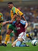Photo. Daniel Hambury.Digitalsport<br /> Barclays Premiership.    <br /> Norwich City v Aston Villa.<br /> 18/09/2004.<br /> Norwich City's Youssef Safri and Aston Villa's Thomas Hitzlsperger