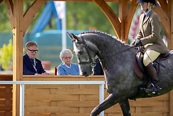 Queen Elizabeth II watches a horse compete during day one of the Royal Windsor Horse Show at Windsor Castle, Berkshire.