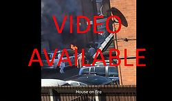 © Licensed to London News Pictures. 08/07/2017. Bolton, UK.   Local resident phone footage - a  6 second clip shows the start of the fire before the arrival of the emergency services -  at a property in Bolton, Greater Manchester in which a woman and three children have died. PLEASE CALL FOR PRICES. Photo credit: Joel Goodman/LNP<br /> <br /> Download video at http://tinyurl.com/ybowee6q