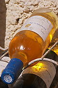 White 1993, and red 1993 in a wine rack. Domaine Le Nouveau Monde. Terrasses de Beziers. Languedoc. Bottle cellar. France. Europe. Bottle.
