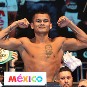 LAS VEGAS, NV - SEPTEMBER 12: Marcos Maidana poses on the scale during his official weigh-in at the MGM Grand Garden Arena on September 12, 2014 in Las Vegas, Nevada. Maidana will challenge WBC/WBA welterweight champion Floyd Mayweather Jr. for his titles against on September 13 in Las Vegas.  (Photo by Alex Menendez/Getty Images) *** Local Caption *** Floyd Mayweather Jr; Marcos Maidana