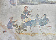 Roma children's chariot race from The Vestibule of The Smnall Circus, room no 41 - Roman mosaics at the Villa Romana del Casale which containis the richest, largest and most complex collection of Roman mosaics in the world, circa the first quarter of the 4th century AD. Sicily, Italy. A UNESCO World Heritage Site. .<br /> <br /> If you prefer to buy from our ALAMY PHOTO LIBRARY  Collection visit : https://www.alamy.com/portfolio/paul-williams-funkystock/villaromanadelcasale.html<br /> Visit our ROMAN MOSAICS  PHOTO COLLECTIONS for more photos to buy as buy as wall art prints https://funkystock.photoshelter.com/gallery/Roman-Mosaics-Roman-Mosaic-Pictures-Photos-and-Images-Fotos/G00008dLtP71H_yc/C0000q_tZnliJD08