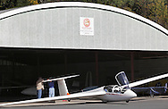 Wurtsboro, New York - Two men work on the tail of a glider at Wurtsboro Airport on Oct. 9, 2010.