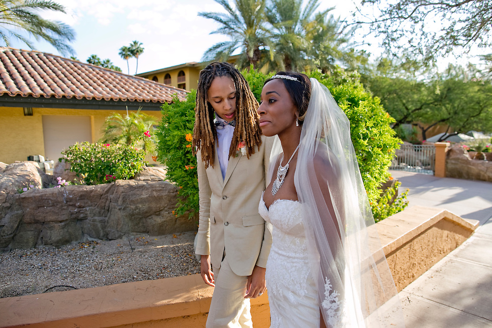 Phoenix Mercury center Brittney Griner, left and Glory Johnson, a fellow WNBA star who plays for the Tulsa Shock, walk to their wedding reception in Phoenix, Ariz. on May 8, 2015.