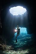 free-diver Sandy Hammel explores a coastal lava tube known as Skull Cave, Kohanaiki, Kona, Hawaii, USA ( Central Pacific Ocean ) MR 489