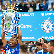 Didier Drogba lifts the trophy as Chelsea celebrate winning the Premier League Title after the Barclays Premier League match at Stamford Bridge, London<br /> Picture by Jack Megaw/Focus Images Ltd +44 7481 764811<br /> 24/05/2015
