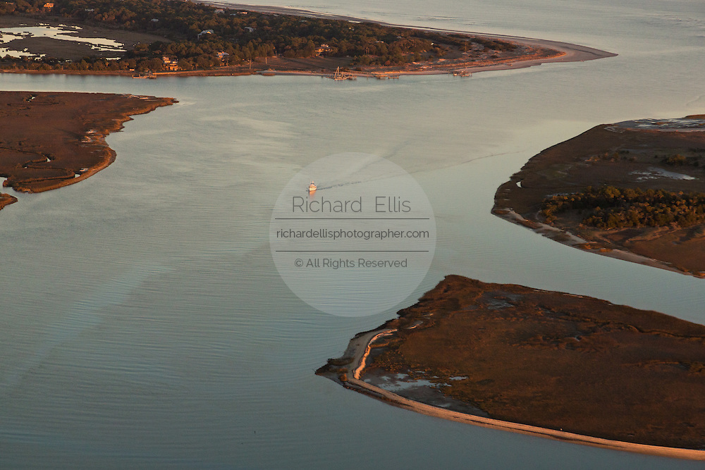 Aerial view of a boat entering the intracoastal waterway from an inlet in Charleston, SC