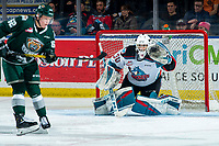 KELOWNA, BC - FEBRUARY 28: Michal Gut #62 of the Everett Silvertips attempts to dodge a shot on net as Roman Basran #30 of the Kelowna Rockets readies to make a glove save at Prospera Place on February 28, 2020 in Kelowna, Canada. (Photo by Marissa Baecker/Shoot the Breeze)