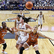UNCASVILLE, CONNECTICUT- DECEMBER 4: Audrey-Ann Caron-Goudreau #31 of the Texas Longhorns prepares to rebound while challenged by Natalie Butler #51 of the Connecticut Huskies during the UConn Huskies Vs Texas Longhorns, NCAA Women's Basketball game in the Jimmy V Classic on December 4th, 2016 at the Mohegan Sun Arena, Uncasville, Connecticut. (Photo by Tim Clayton/Corbis via Getty Images)