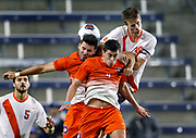 Clemson's Kyle Murphy, left, Oliver Shannon, center, and Syracuse's Oyvind Alseth, right, go up for the ball as Syracuse defender Louis Cross (5) looks on in the second half of an NCAA College Cup soccer match, Friday, Dec. 11, 2015, in Kansas City, Kan. (AP Photo/Colin E. Braley)