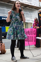 London, UK. 29 July, 2019. Amelia Womack, Deputy Leader of the Green Party, addresses activists from Reclaim the Power, All African Women's Group, Docs Not Cops, Lesbians and Gays Support the Migrants and other groups at a protest outside the Home Office to demand an end to the Government's 'hostile environment' policies.