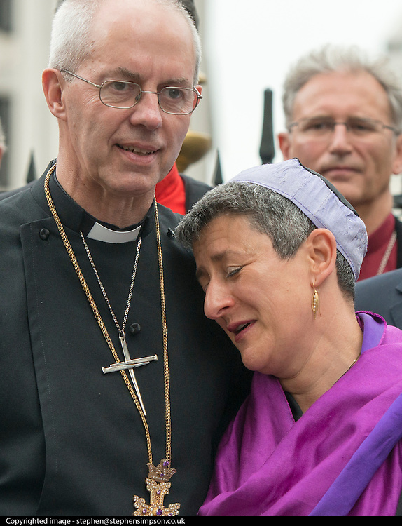 © Licensed to London News Pictures. 03/09/2014. London, UK. Justin Welby puts his arm around Rabbi Laura Janner-Klausner.  The Archbishop of Canterbury, Justin Welby, attends an inter-faith vigil outside Westminster Abbey. Other speakers include Imam Ibrahim Mogra of the Muslim Council of Britain, Rabbi Laura Janner-Klausner of the Movement for Reform Judaism and Ayatollah Dr Sayyid Fadhil H Al-Milani.. Photo credit : Stephen Simpson/LNP