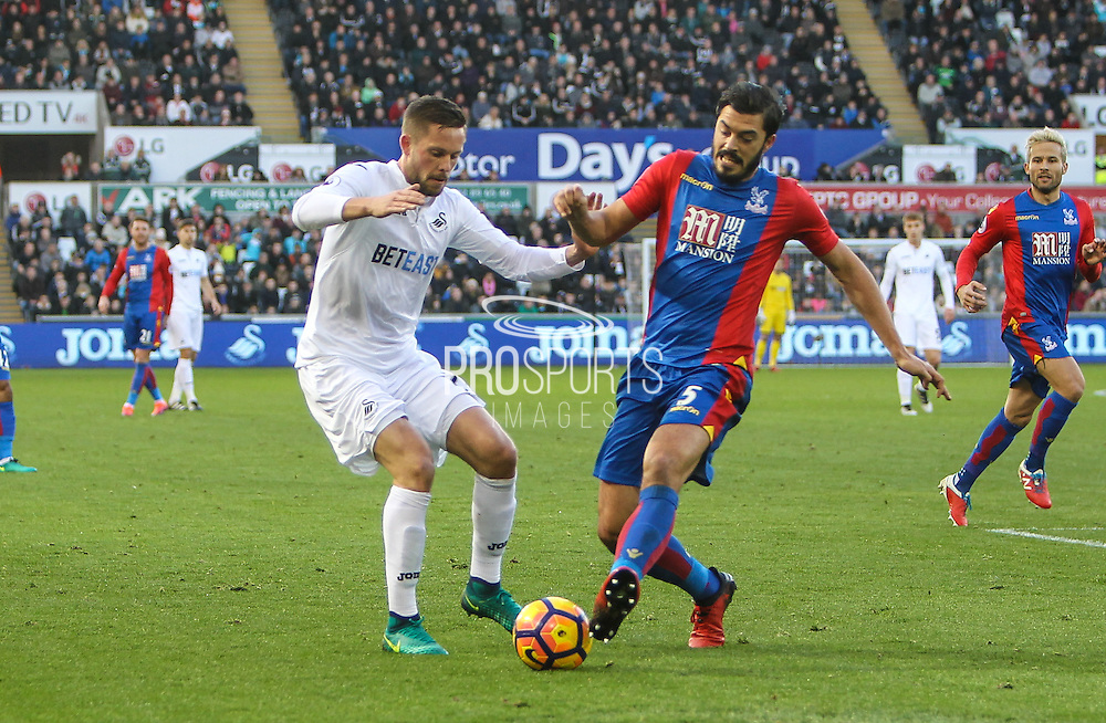 Gylfi Sigurdsson of Swansea City and James Tomkins of Crystal Palace during the Premier League match between Swansea City and Crystal Palace at the Liberty Stadium, Swansea, Wales on 26 November 2016. Photo by Andrew Lewis.