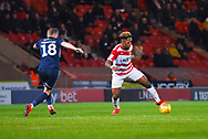 Mallik Wilks of Doncaster Rovers (7) controls the ball under pressure from Sam Mantom of Southend United (18) during the EFL Sky Bet League 1 match between Doncaster Rovers and Southend United at the Keepmoat Stadium, Doncaster, England on 12 February 2019.