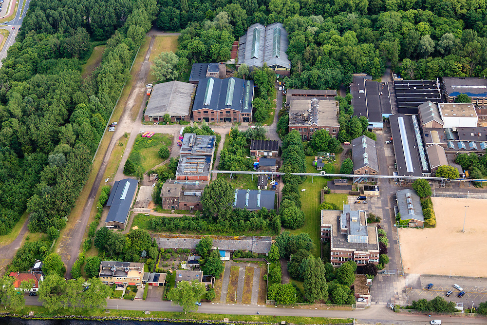 Nederland, Noord-Holland, Zaandam, 14-06-2012; Hembrugterrein van voorheen Eurometaal, wapen en munitie fabriek. Ook bekend als Artillerie-Inrichtingen, oorspronkelijk onderdeel van de Stelling van Amsterdam. Veel van gebouwen zijn monumenten, het complex wacht op een nieuwe bestemming..Former (secret) defense area including Military Complex Hembrug and ammunition factory Euro Metal. Former military heart of the Stelling van Amsterdam, strategically located at Zaan and Noordzeekanaal. Many buildings are landmarks, the area is awaiting a new use / reuse..luchtfoto (toeslag), aerial photo (additional fee required).foto/photo Siebe Swart