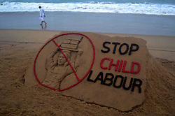 June 11, 2017 - Bhubaneswar, Orissa, India - A sand art is seen on the Bay of Bengal Sea's eastern coast beach at Puri as it creating by International sand artist Sudarshan Pattnaik for public awareness on the occassion of World No Child Labor Day, 65 km away from the eastern Indian state Odisha's capital city Bhubaneswar on 12 June 2017. (Credit Image: © Str/NurPhoto via ZUMA Press)