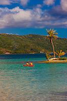 A couple kayaking in the lagoon, Four Seasons Resort Bora Bora, French Polynesia.