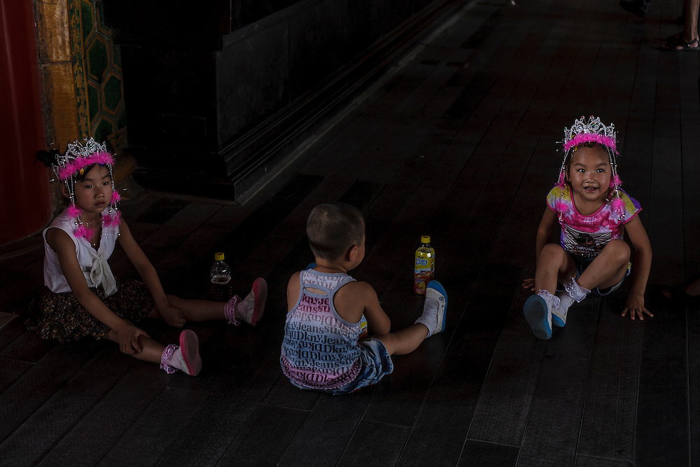 Young Children take a rest inside the Forbidden City in Beijing.