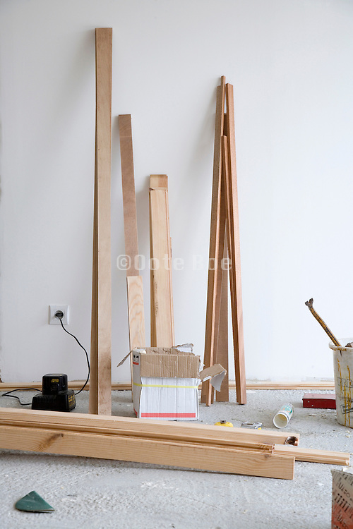 various wood pieces placed against a wall in a house under construction