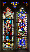 Stained glass window Caritas or Charity, Bedingfield church, Suffolk, England, UK c 1881 W G Taylor on left, right Raising of Jairus' daughter c 1865 prob William Miller