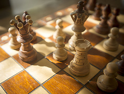 Oct. 25, 2015 - Orange County, California, U.S - Chess pieces on a chessboard await a player's next move as autumn dappled afternoon light shines across the game board. (Credit Image: © David Bro/ZUMA Wire)