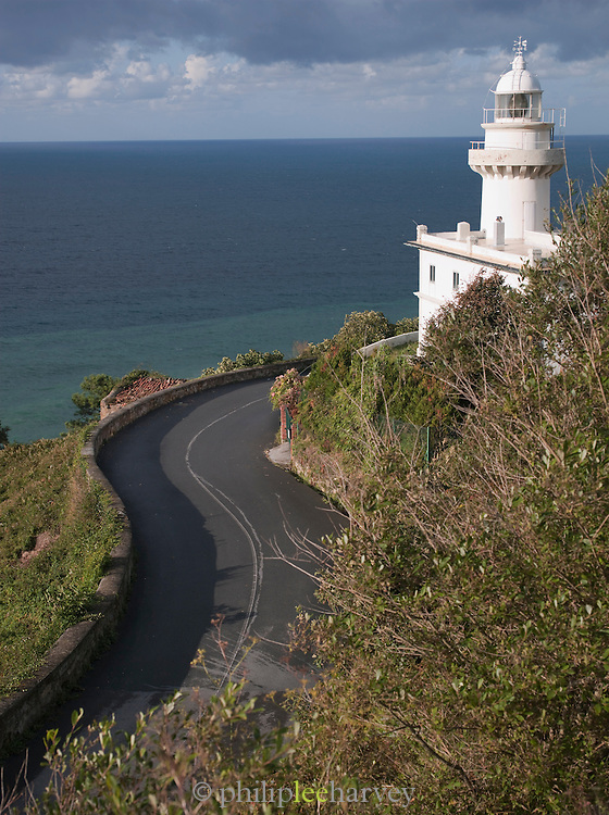 A winding road leads up to the Monte Igueldo Lighthouse, built on a hilltop above San Sebastian, Spain