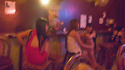 SEX INDUSTRY TOURISM. South East Asia, Cambodia, Phnom Penh. Taxi girls, prostitutes, serve foriegn tourists & Khmer, Cambodians. The sex industry is part of the fabric, servicing all classes of Cambodian society. Girls are forced into prostitution because of poverty and corruption that exists across the country. People might earn 1 to 2 $ per day, even less in rural areas, so the lure of prostitution is high. Families can sell young girls, virgins, for several hundred dollars. Cheap brothels line the streets in parts of the city centre, near railway tracks, and on the periphery. Sex for Cambodians at cheap prices in the street brothels, as low as 1 $ US, to exorbitant fees in penthouse hotel suites for the rich. Sex tourism industry attracts Western and Asian tourists typically paying 10 - 30 $ US. Expressions such as 'yam yam', eating, for a blowjob 'bam bam' for intercourse. There are 'lady-boys', youths, who use the money to pay for  sex change operations. Prostitutes spend lots of money on make-up, clothes, and mobile telephones. They live in squalor. Due to public advertising campaigns and outreach work, Aids and HIV cases have dramatically decreased, in Cambodia, since the late '90s. Condoms are encouraged, are cheap and widely available. This is seen as  a success story by medical and health authorities. There are risks as ex-prostitutes known as 'sweethearts' don't use condoms with their partners. Brothels, v & madams take their cut, but many taxi-girls work as free agents. Bars, pool halls or beer gardens have staff and taxi-girls available to service male clients, some work as barmaids or escorts. There is violence against prostitutes; gang-rape and murder by Khmer gangs. Once a girl has worked as a prostitute it is unlikely she can ever marry.///Prostitutes waiting for clients in a brothel