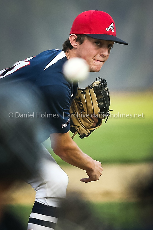 (7/21/14, SUDBURY, MA) Ashland Post 77's Evan Park delivers a pitch during the American Legion playoff game against Sudbury Post 191 at Feeley Field in Sudbury on Monday. Daily News and Wicked Local Photo/Dan Holmes