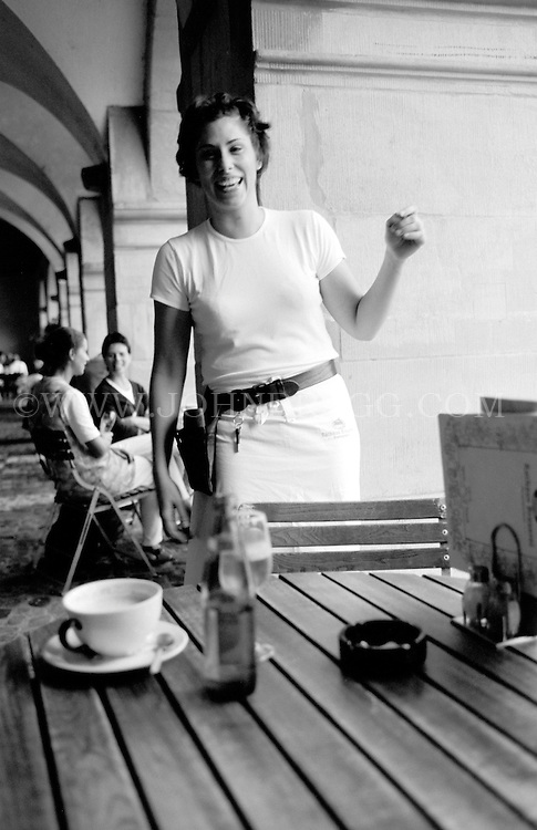 Black and white photo of a waitress, restaurant in Lucerne, Switzerland.
