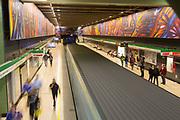 People on subway station platform in blurred motion, Santiago, Chile