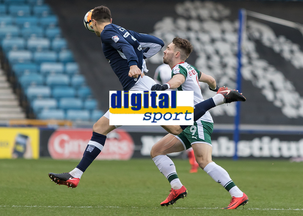 Football - 2017 / 2018 FA Cup - Third Round: Millwall vs. Barnsley<br /> <br /> Jake Cooper (Millwall FC) clears the ball in front of an on rushing Tom Bradshaw (Barnsley FC) at The Den.<br /> <br /> COLORSPORT/DANIEL BEARHAM