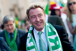 © Licensed to London News Pictures. 16/03/2014. London, UK. Michael Flatley enjoying the festivities at the annual St Patrick's Day parade as it moves through London from Green Park to Trafalgar Square. Photo credit : David Tett/LNP