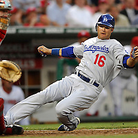 30 May 2007:  Los Angeles Dodgers right fielder Andre Ethier (16) slide safely into home in the 5th inning on an RBI single by shortstop Rafael Furcal as Washington Nationals catcher Brian Schneider (23) takes the late throw home.  The Dodgers defeated the Nationals 5-0 at RFK Stadium in Washington, D.C.  ****For Editorial Use Only****