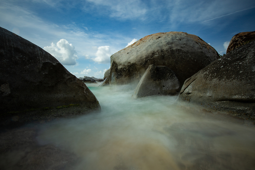 Ocean water flowing between the giant boulders lining the beaches at Virgin Gorda's Baths.