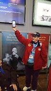 Then and Now. Iris Freespirit showing her military photo at The Women's Memorial, Washington DC.