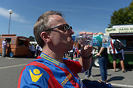 a Crystal Palace fan drinks a bottle of water to cool down in the heat outside Selhurst Park before k/o in the hot weather. Barclays Premier league match, Crystal Palace v Aston Villa at Selhurst Park in London on Saturday 22nd August 2015.<br /> pic by John Patrick Fletcher, Andrew Orchard sports photography.