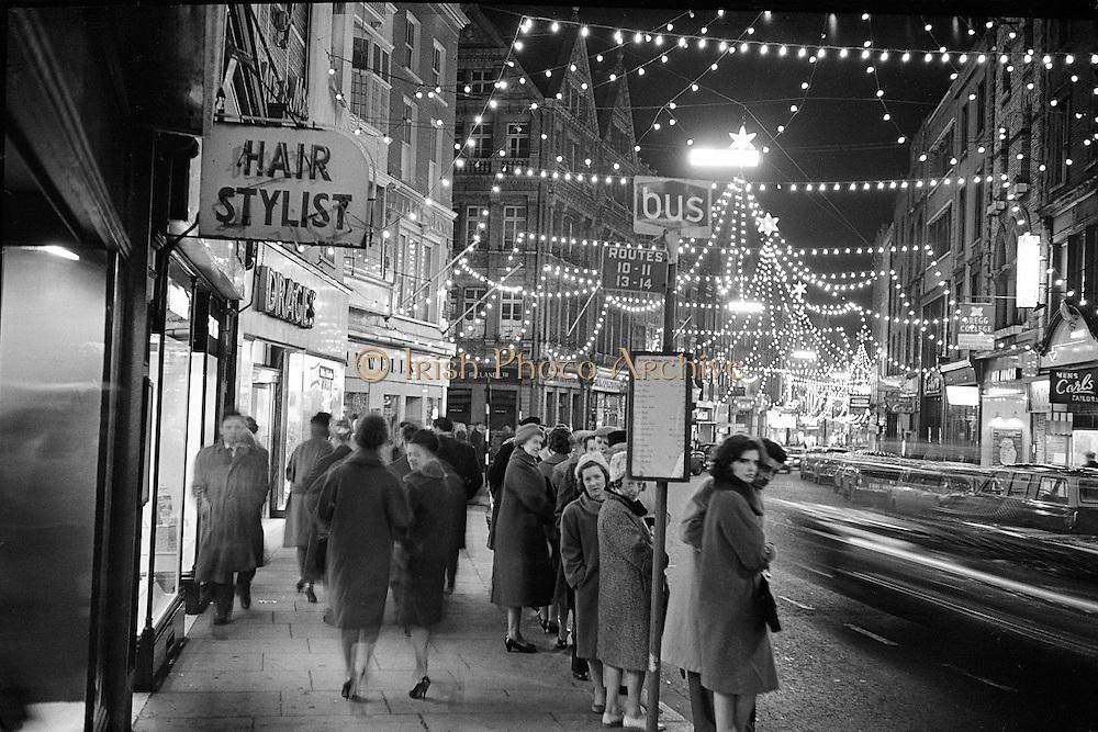 Waiting for the bus under the Christmas lights, Grafton Street, Dublin..09.12.1961