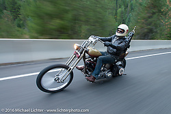 Sean Duggan riding his 1936 Harley-Davidson Knucklehead chopper on this 39 degree (27 degree windchill) morning during stage 14 - (284 miles) of the Motorcycle Cannonball Cross-Country Endurance Run, which on this day ran from Meridian to Lewiston, Idaho, USA. Friday, September 19, 2014.  Photography ©2014 Michael Lichter.