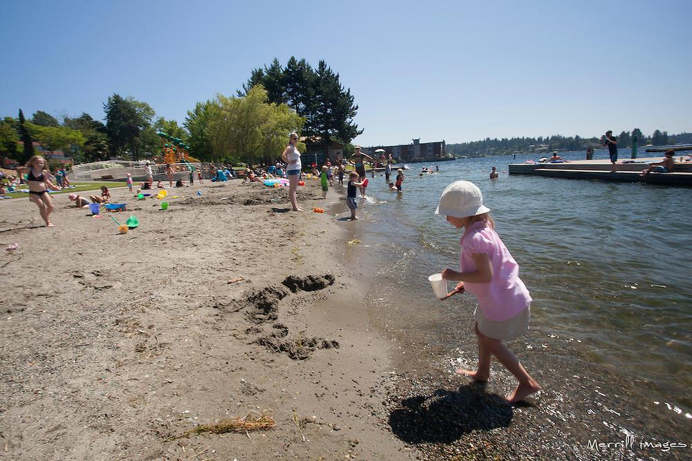 North America, United States, Washington, Kirkland, children play on beach by Lake Washington