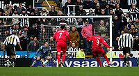Photo: Andrew Unwin.<br /> Newcastle United v Liverpool. The Barclays Premiership. 19/03/2006.<br /> Liverpool's Djibril Cisse (#9) scores his team's third goal from the penalty spot.