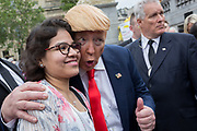 On US President Donald Trump's second day of a controversial three-day state visit to the UK, a Trump lookalike engages with protesters voicing their opposition to the 45th American President, in Trafalgar Square, on 4th June 2019, in London England.