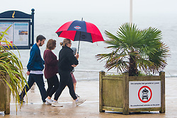 © Licensed to London News Pictures. 16/09/2018. Aberystwyth, UK. People walking along the seafront promenade in Aberystwyth, Wales on a wet and dreary September Sunday afternoon. The west of the UK is bracing itself for the impact of Storm Helene, which is predicted to strike overnight on Monday, with winds gusting up to 70mph in exposed areas. Photo Credit: Keith Morris/LNP