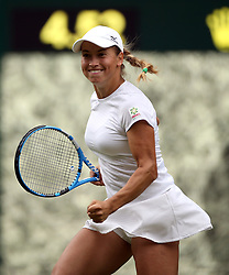 Yulia Putintseva celebrates winning a point after it goes to hawk eye on day one of the Wimbledon Championships at the All England Lawn Tennis and Croquet Club, Wimbledon.