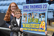 Two young Coventry City fans with their home made banner bidding farewell to Coventry City midfielder (on loan from Derby County Luke Thomas (23) during the EFL Sky Bet League 1 match between Coventry City and Shrewsbury Town at the Ricoh Arena, Coventry, England on 28 April 2019.