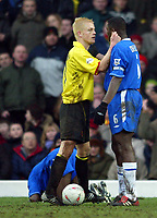 Photograph: Scott Heavey.<br /> Watford v Chelsea. FA Cup Third Round. 03/01/2004.<br /> Heider Helguson intimidates Marcel Desailly after fouling Geremi