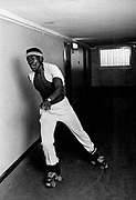 Youth roller skating in corridor.  Photo by Richard Saunders 1983